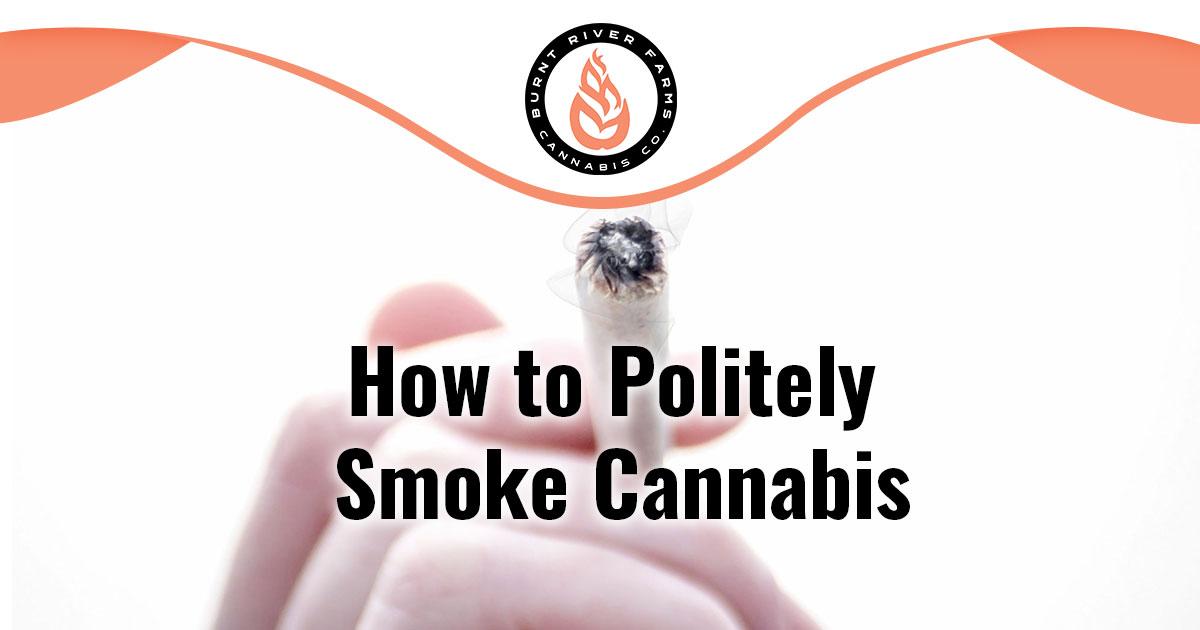 Hand holding a lit marijuana joint